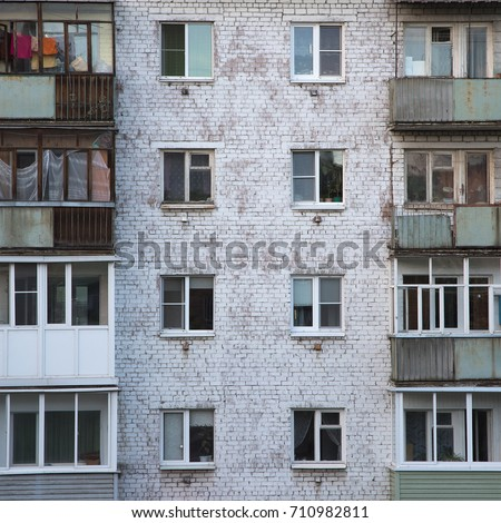 brick apartment building. Windows and balconies of the old brick apartment building in Russia Balconies Old Brick Apartment Building Stock Photo  Royalty