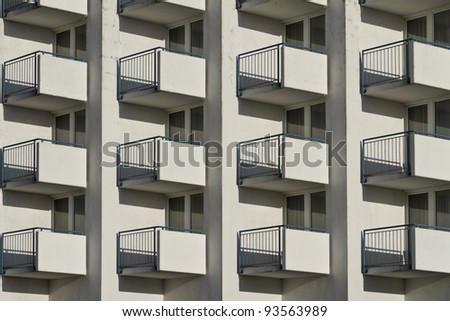 windows and balcony in apartment building - stock photo