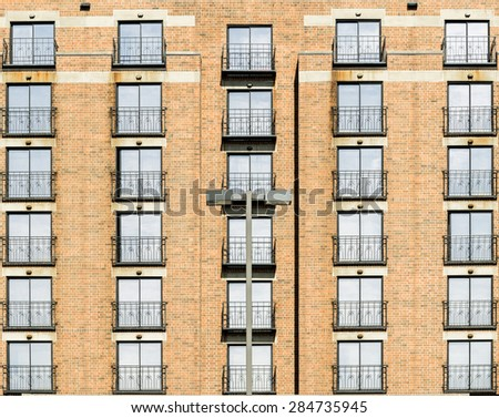 Windows and balcony of a modern apartment building - stock photo