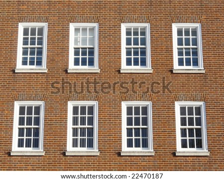 Windows and brick exterior of a Georgian style property in London, England