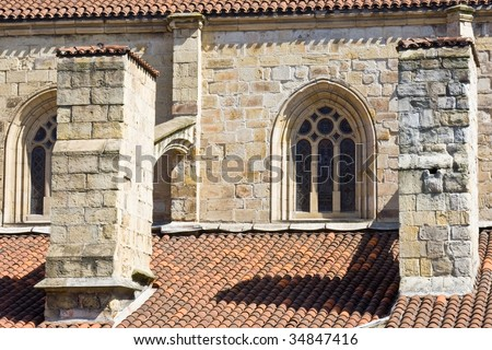 Windows and columns of an old building - stock photo
