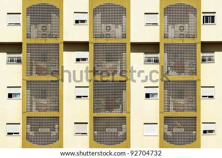 Windows and decorated balconies of a modern building - stock photo