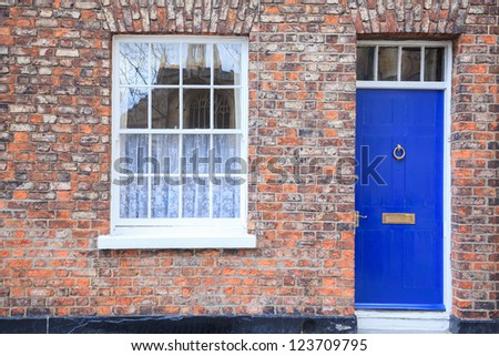 Windows and door on Gothic style Brick house - stock photo