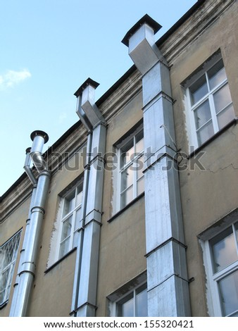 Windows and ventilation tubes in old city of Vilnius, Lithuania - stock photo