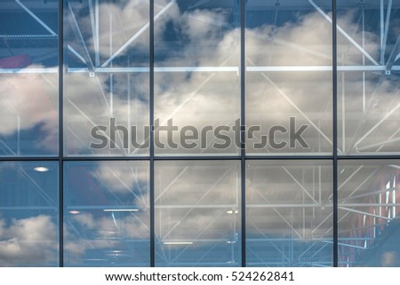 windows, clouds and sky reflections