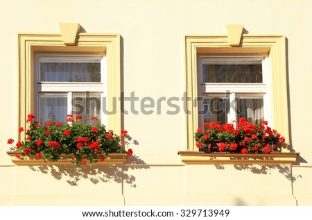 Windows decorated with red flowers in flower boxes, Old town of Prague, Czech Republic
