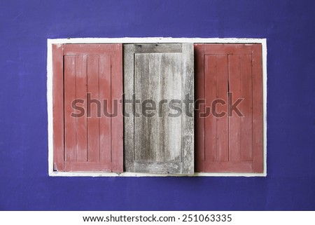 Windows in a blue wall  - stock photo