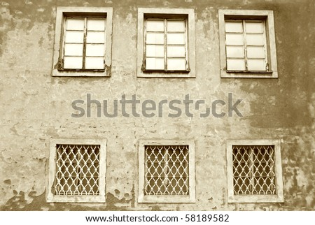 Windows in old house. Sepia version. - stock photo
