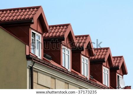 Windows in the attic. - stock photo