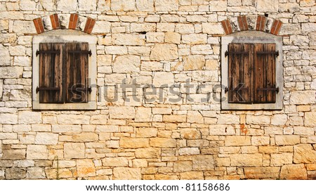 Windows in the old stone wall - stock photo