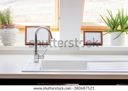 windows in white contemporary kitchen - stock photo