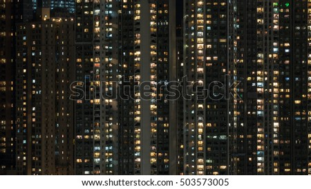 Windows lights in high-rise apartment house in night Hong Kong