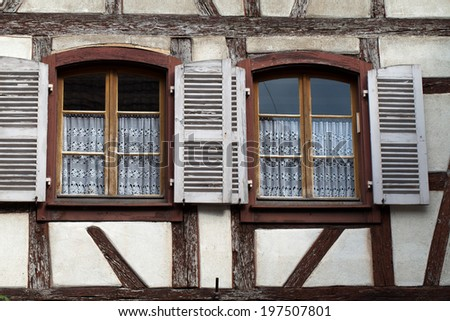 Windows of a house in Eguisheim, Alsace, France  - stock photo