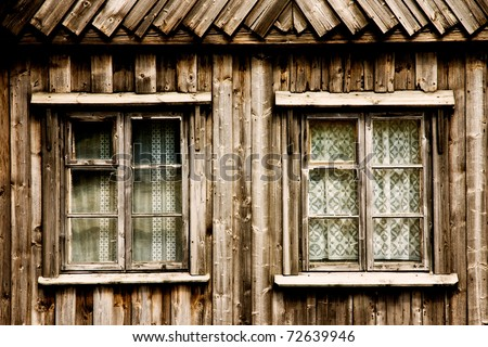 Windows of a wooden cottage - stock photo