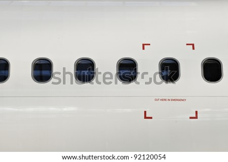 Windows of airplane with emergency sign. - stock photo