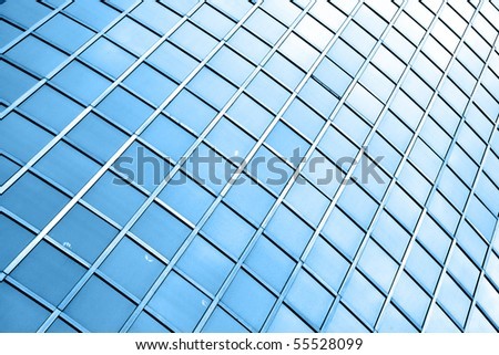 Windows of modern building toned in blue color - stock photo