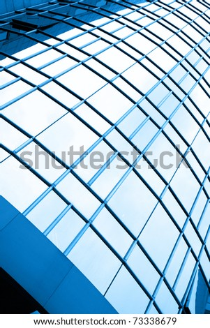 Windows of modern building toned in blue color