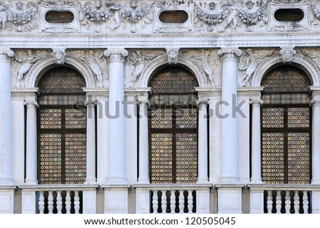 Windows of National Library of St Mark's in Venice, Italy - stock photo