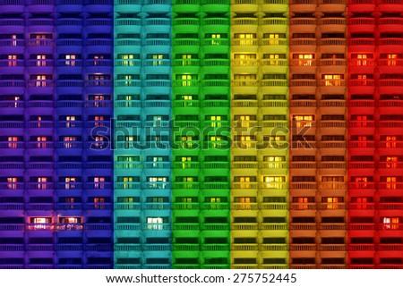 Windows of night apartment with rainbow  - stock photo
