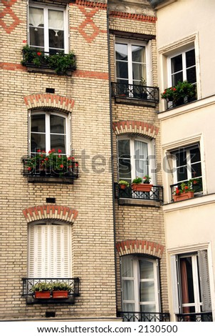 Windows of old apartment buildings in Paris France