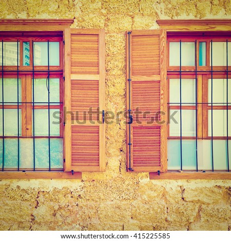 Windows of Old Building after Reconstruction in Tel Aviv, Instagram Effect - stock photo
