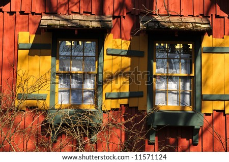 Windows of old rural and colorful house with blue sky