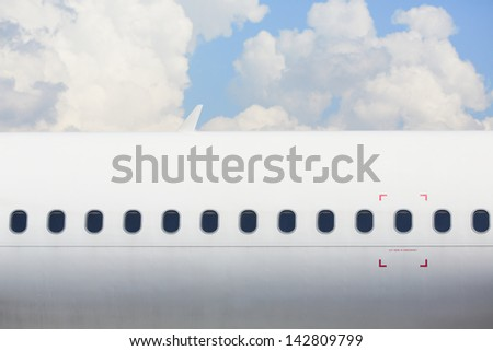 Windows of the white airplane - copy space - stock photo