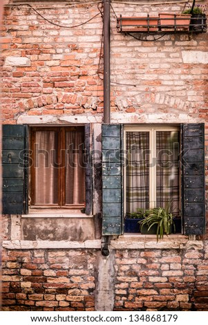Windows on a typical Venice wall of house - stock photo