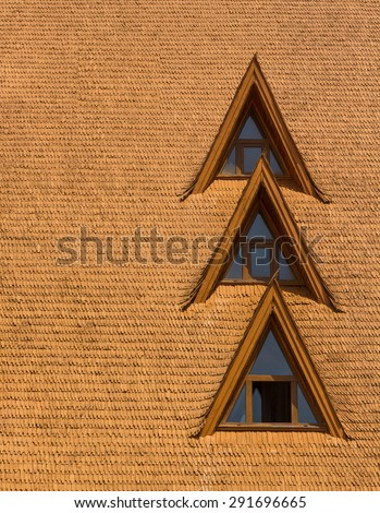 Windows on a wood shingle roof - stock photo