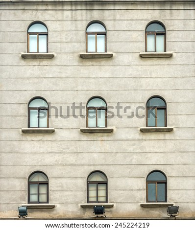 Windows on an antique building - stock photo