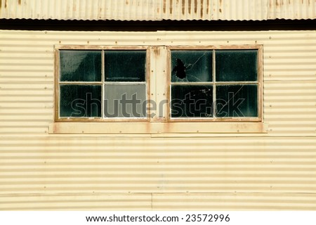 Windows on old corrugated metal building stock photo 23572996 windows on an old corrugated metal building sciox Image collections