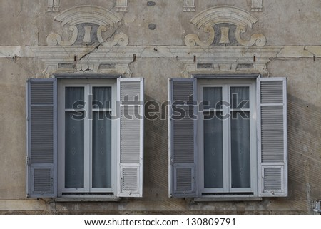 Windows on historical Italian wall - stock photo