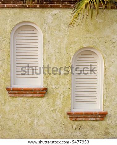 Windows on spanish style building - stock photo
