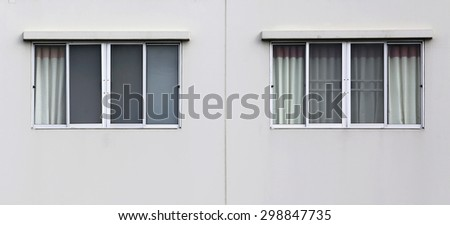 Windows on the outside of a apartment - stock photo