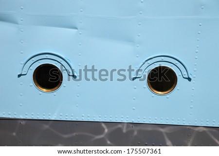 Windows - the porthole at a military ship. - stock photo