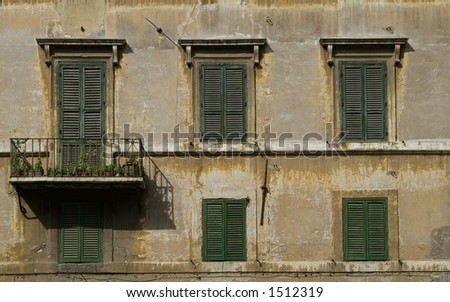 Windows with blinds on an old building at Piazza Farnese in Rome, Italy