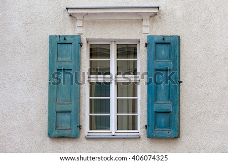 Windows with closed shutters.