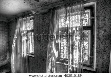 Windows with curtains in old abandoned house in czech village  - stock photo