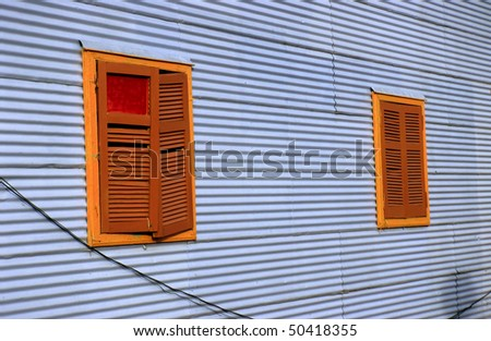 Windows with folding shutters in La Boca - stock photo