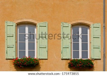 Windows with Open Wooden Shutters, Decorated with Fresh Flowers - stock photo