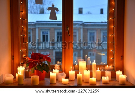 Windowsill with Christmas decorations - stock photo