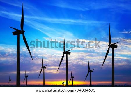Windpark at sunset - stock photo