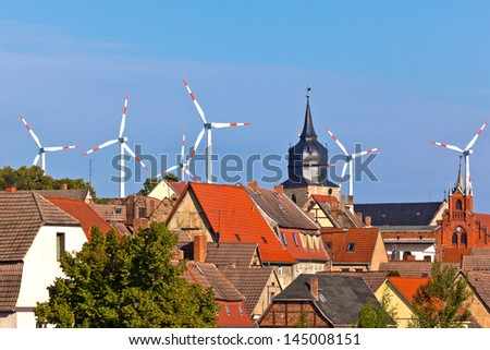 windpower and city - stock photo