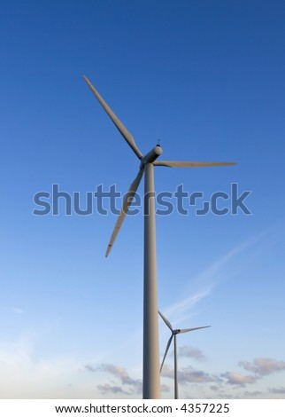 windpower turbines against a blue summer sky
