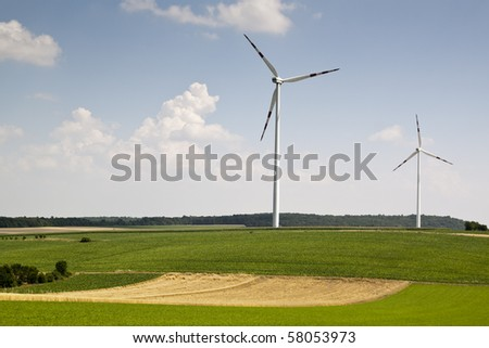 windpower with sun and blue sky - stock photo