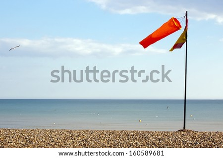 windsock against clear sky at seacoast, Brighton - stock photo
