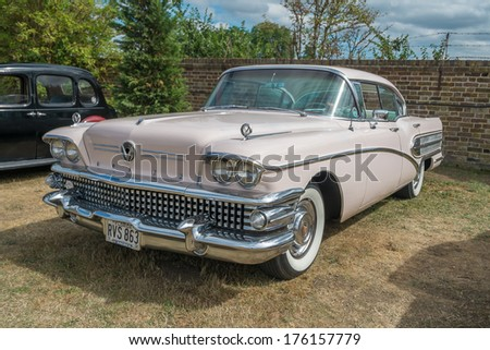 WINDSOR, BERKSHIRE, UK- Augsut 4, 2013: 1958 pink Buick Limited Classic car on show at Windsor Farm Shop International Classic Car Show in August 2013 - stock photo