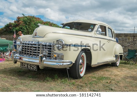 WINDSOR, BERKSHIRE, UK- August 4, 2013: A cream Dodge Coronet Classic car on show at Windsor Farm Shop International Classic Car Show in August 4 2013 - stock photo