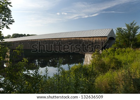 Windsor-Cornish bridge is the longest covered bridge in New England. It crosses between New Hampshire and Vermont, over the Connecticut River. - stock photo