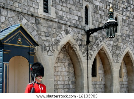 WINDSOR, ENGLAND - CIRCA 2008: English guard and lamp at Windsor Castle